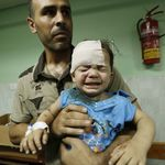 A Palestinian child, wounded in an Israeli strike on a compound housing a UN school