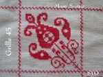 SAL : Plaid Broderie Rouge... Grille 45 / E7