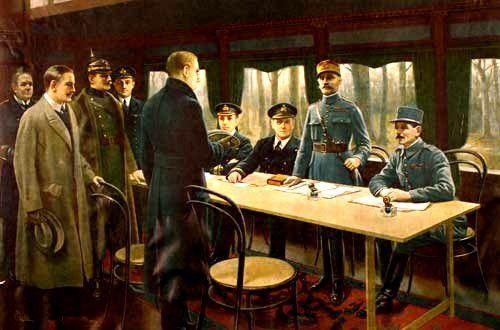 La signature de l'Armistice de 1918 dans le wagon-salon du maréchal Foch. Derrière la table, de droite à gauche, le général Weygand, le maréchal Foch (debout) et les amiraux britanniques Rosslyn Wemyss et G. Hope (en). Devant, le ministre d'État allemand Matthias Erzberger, le général major Detlof von Winterfeldt (avec le casque) de l'Armée impériale, le comte Alfred von Oberndorff des Affaires étrangères et le capitaine de vaisseau Ernst Vanselow de la Marine impériale.