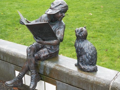 Girl reading to her cat, Longview, Public Library, Washington