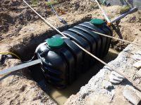 Creusage du trou de fosse et pompage de l'eau de surface