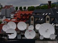 Arrivée pluvieuse, après enregistrement, vues de Bergen depuis le pont 7 à la poupe du bateau.