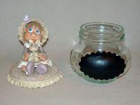 Pot douceur avec bébé fillette en porcelaine froide