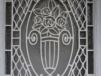 Grille fer forgé entière 1930, vue de jour, architecture normande, Cl. Elisabeth Poulain
