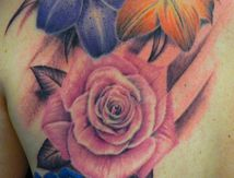 flowers tattoo by christophe duquenne