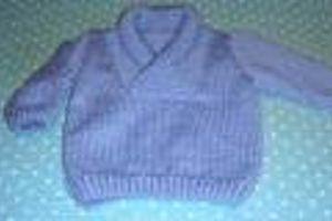 Joli petit pull au tricot