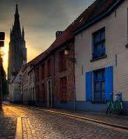 L'Enfant de Bruges et Gilbert Sinoué : au pays des maisons en escaliers
