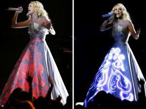 """Das wohl spektukalärste Kleid des Abends trug Carrie Underwood. Wie man ganz links sieht ist es ganz weiß, doch während ihres Auftrittes wurde als Leinwand benutzt. Sie gewann einen Grammy in der Kategorie """"Best Country Solo Performance"""""""