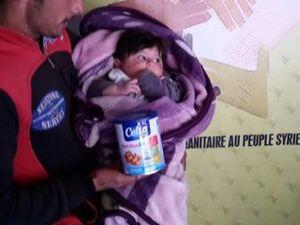 A Alep, la distribution de lait infantile continue