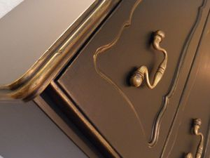 commode noire dorée style baroque