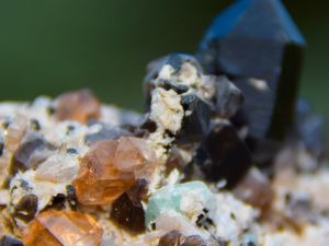 Topaz with Morion and Hiddenite from Paprok mine, Kamdesh District, Nuristan Province, Afghanistan (size: Small cabinet)