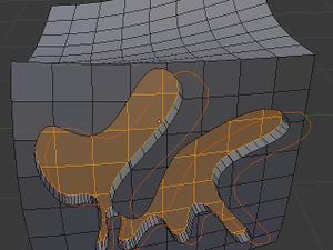 Découpépage à l'aide d'une courbe (ou d'un maillage non remplit), puis extrusion.
