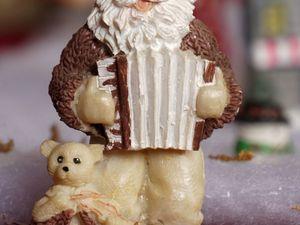 Père Noël et boulle de neige