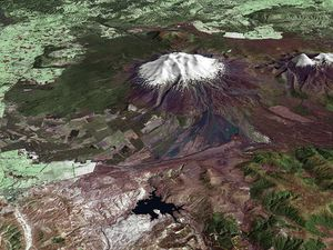 Aerial view of Ruapehu - left in October 2002 - on the right, we see the trace of the lahar 25.03.2007 - Doc. NASA Terra ASTER. - Click for larger view.
