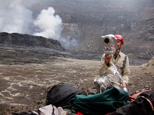 "Olivier Grunewald preparing its equipment and its progress towards the lava lake of Nyiragongo - a click on the pictures to enlarge - Doc. ""Journey to the Center of the World"" / O.Grunewald"