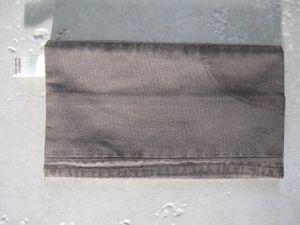 doublure intérieure tissu coton orange à pois blanc, étiquette récup okaïdi, bouton biscuit lu en fimo, boutons de bois ajouré et acrylique fushia