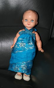 A strapless blue dress which matches the blue eyes of the doll