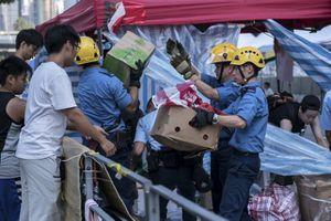Le Monde - Hongkong : les manifestants se retirent de plusieurs sites