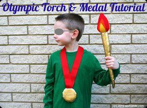 La torche et médaille olympique