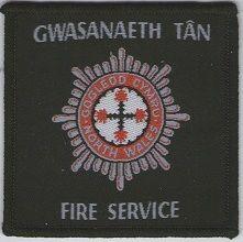 Echange l'écusson des pompiers du comté du PAYS DE GALLE, au Royaume uni