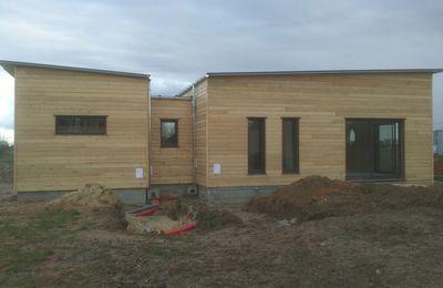 Construction d'une maison en ossature bois plain-pied, toiture terrasse