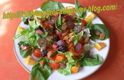 Mixed salad with pink grapes