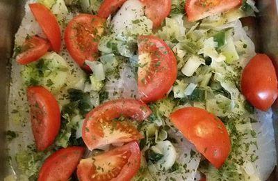Filet de Merlan et son lit de poireaux tomates