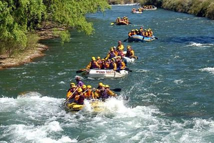 Rishikesh river rafting amid the rocky mountains / Krishna Holidays