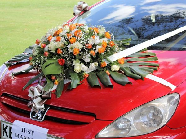I like the way Kenyans decorate cars for the weddings