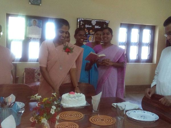 At dining room: cutting the cake...congratulating the jubilarian singing songs....