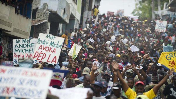 Haitio : plia kolera tago de la opoziciuloj al la prezidento Martelly