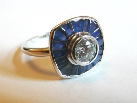 Diamant avec entourage coussin