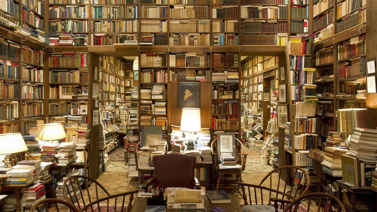 Piles-of-books-in-a-private-college-library_www.LuxuryWallpapers.net_