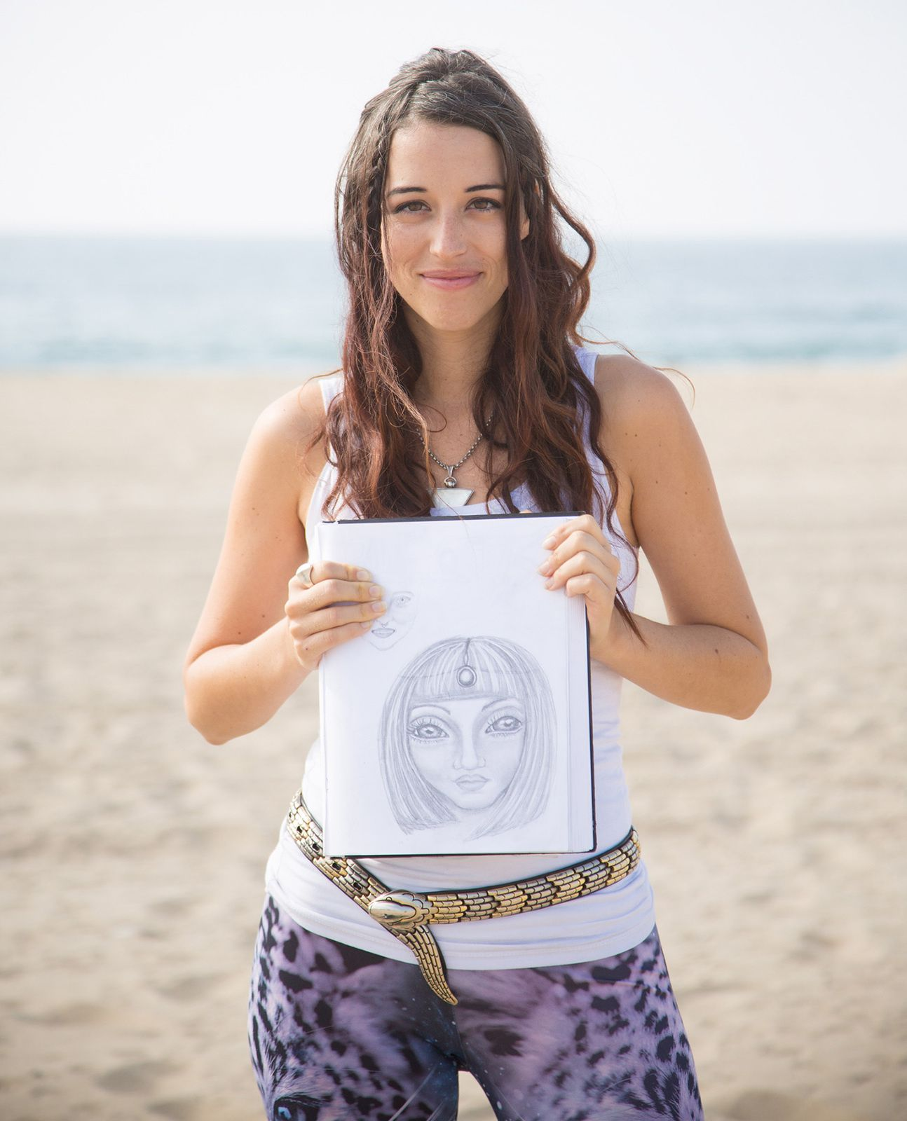 Aluna Verse holds a picture of one of her three alien hybrid babies