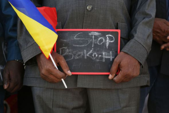 "(Photo: Reuters/Emmanuel Braun)A man holds a sign that reads ""Stop Boko Haram"" at a rally to support Chadian troops heading to Cameroon to fight Boko Haram, in Ndjamena January 17, 2015."