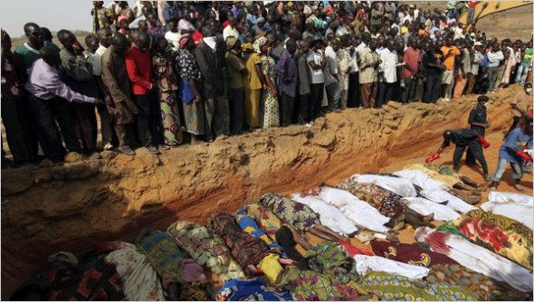 (Photo: Reuters/Credit Akintunde Akinleye)Villagers stood at a mass grave in Dogon Na Hauwa, Nigeria, in 2010.