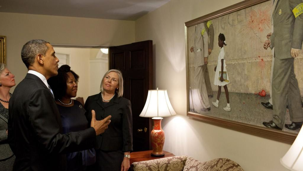 B. Obama, with R. Bridges, in front of the painting, at the White House.