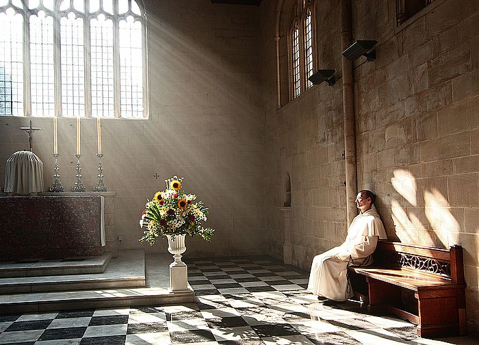 A Dominican friar prays in the presence of the Blessed Sacrament in Blackfriars church, Oxford - enlightened, Fr Lawrence OP