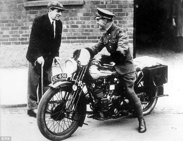 George Brough, inventor and maker of the Brough Superior, with Lawrence of Arabia astride a Brough Superior SS100 motorbike
