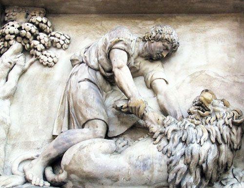 Androclès soigne le lion blessé, qui deviendra son ami et son protecteur. Bas-relief antique.