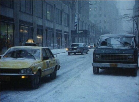 Yellow Peugeot 505 cab in NYC from the Hysteria movie