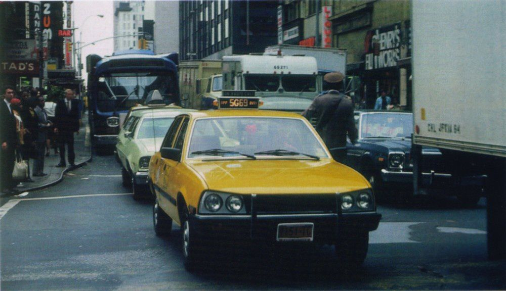 Yellow Peugeot 505 cab in NYC