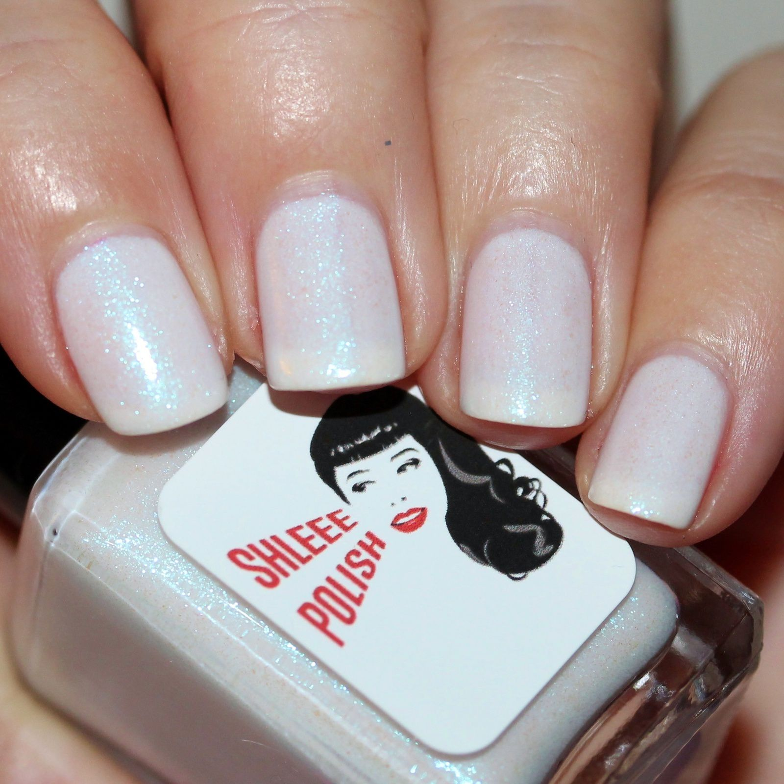 Sally Hansen Complete Care 4-in-1 Extra Moisturizing Nail Treatment / Shleee Polish The First Snow / Native War Paints Hurry, Hurry!Top Coat