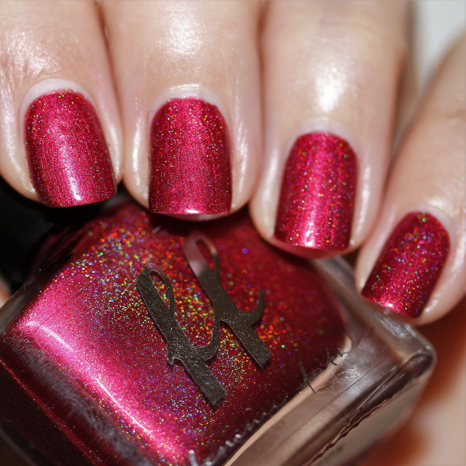 Luckdragon (2 coats no top coat), a bold ruby red scattered holographic.
