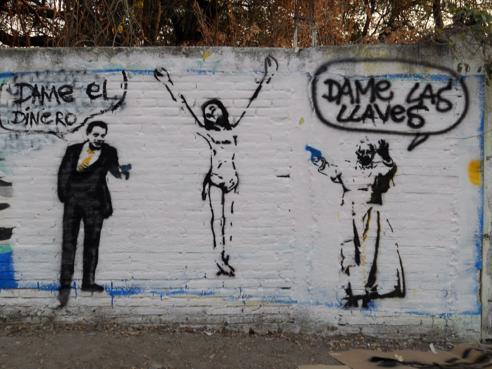 Street-art réalisé par le peintre François à Mexico. Traduction: Donne-moi le fric (à gauche, pasteur évangélique), Donne-moi les clés (à droite, le pape)