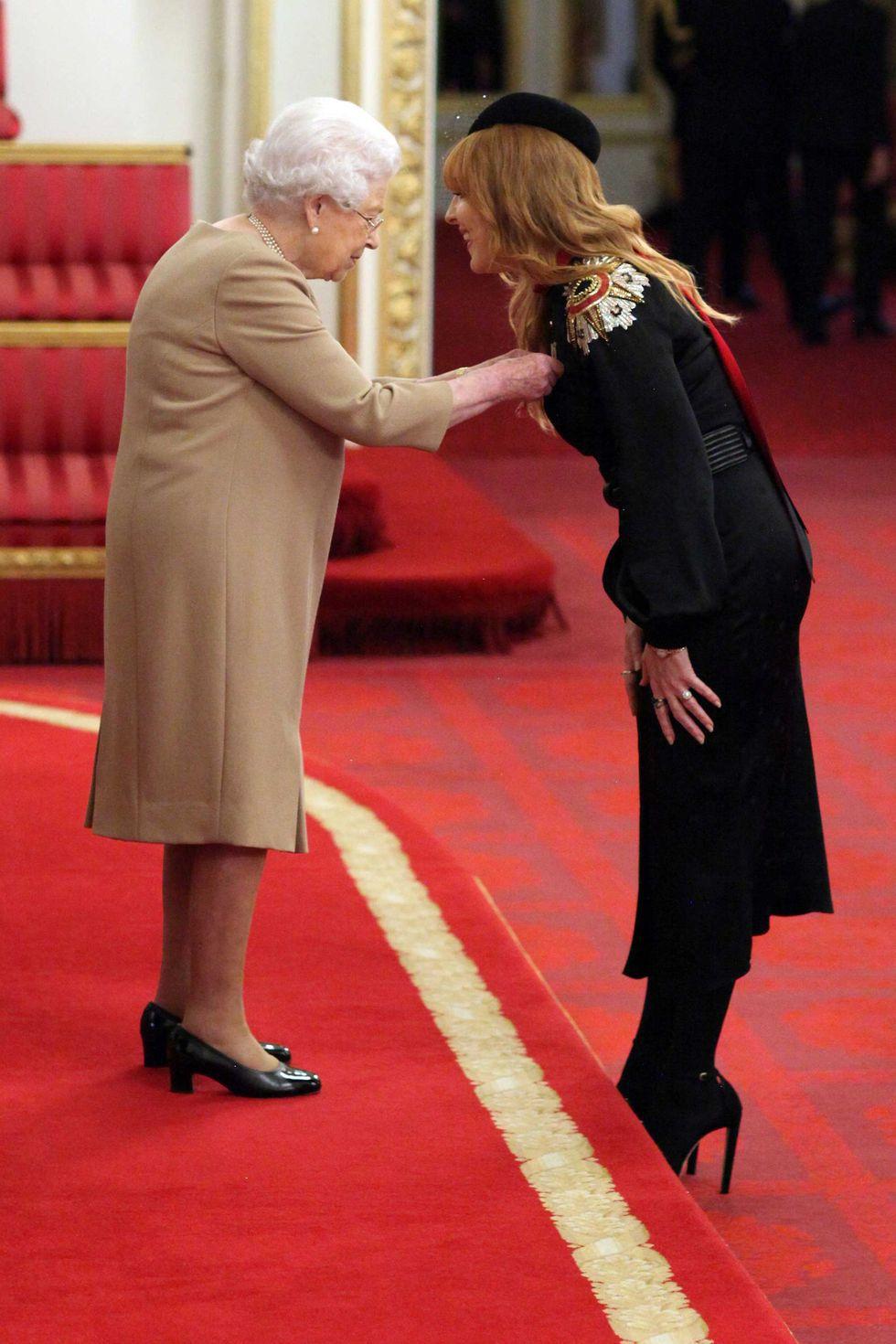 Charlotte Tilbury the Beauty guru  received her MBE at Buckingham Palace