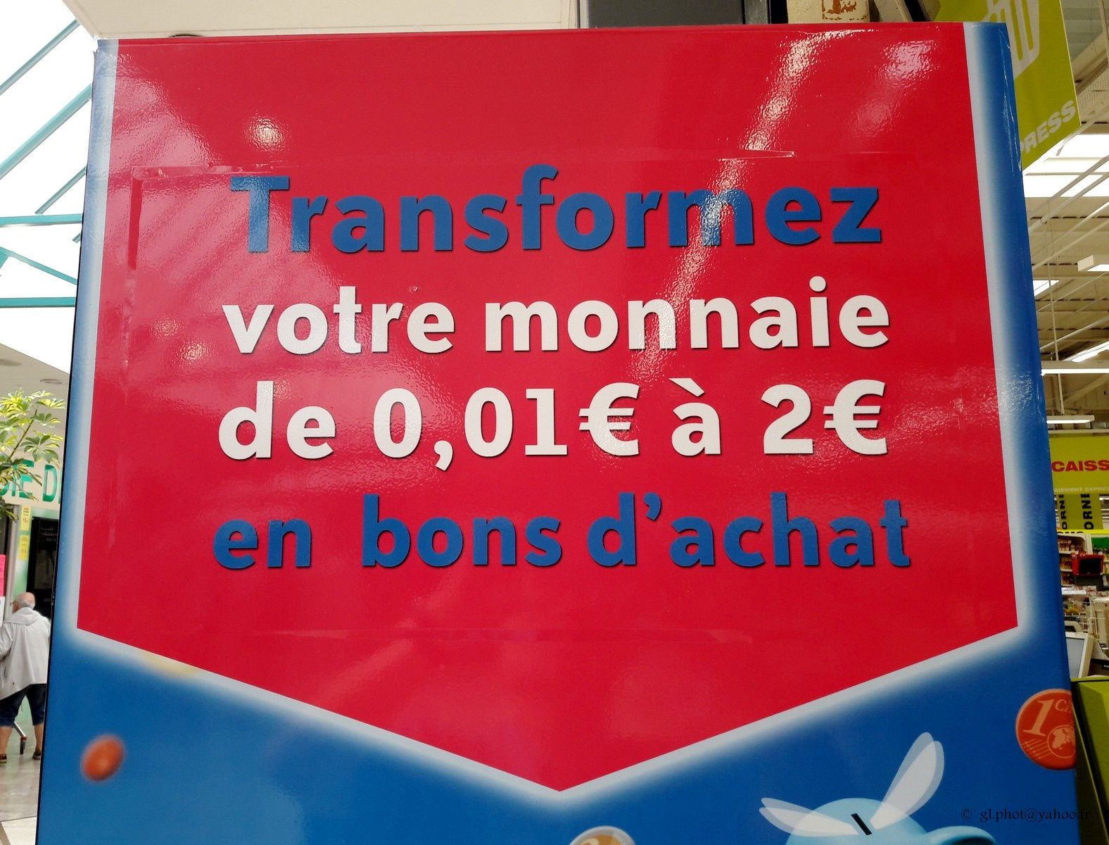 Changeur de monnaie en bon d'achat au centre commercial Auchan d'Osny