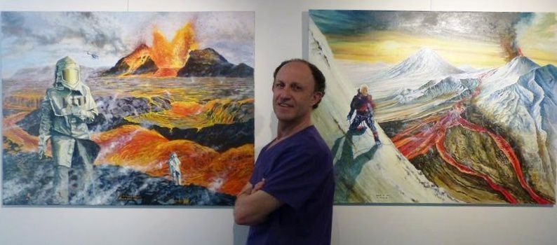 "The artist in front of two of his ""volcanic"" works - photo of his Facebook page"