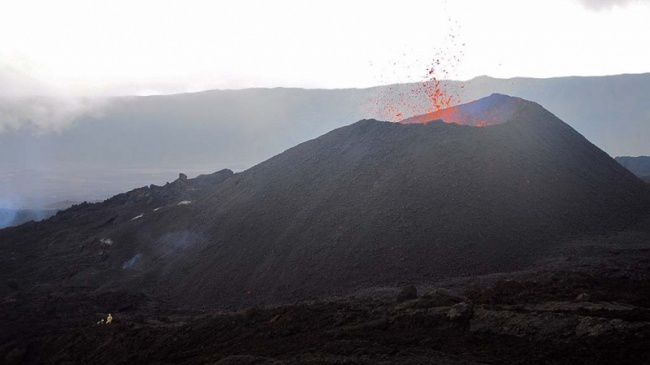 The active cone of Piton de La Fournaise - a character on the left gives the scale - photo Imazpress