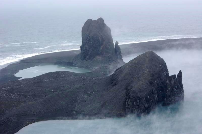 Small flank vent on the northwest coast of Bogoslof formed during one of its last eruptions; It is filled with sea water. - photo Max Kaufman 085.05.2017 / 15:37 / AVO / courtesy of U.S. Coast Guard Air Station Kodiak and U.S.C.G Cutter Mellon.